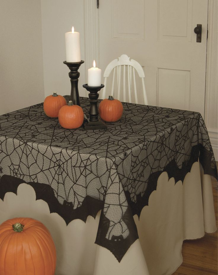 Bats & Spider Webs Table Topper - Dress up your Halloween table with this spooky black lace table topper for only $29.99 - its frightfully fabulous! The 58 x 58 square table topper looks fantastic when placed over a white or orange tablecloth or directly on the table.