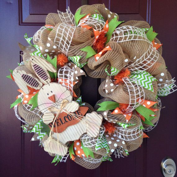 This cute little bunny is nestled in a 25 burlap deco mesh wreath embellished with 5 different styles of orange, lime, and tan ribbon. This