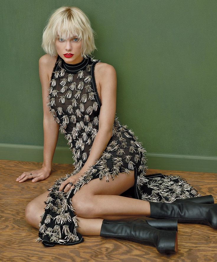 Taylor Swift in the May issue of Vogue wearing a Proenza Schouler dress and Vetements boots.