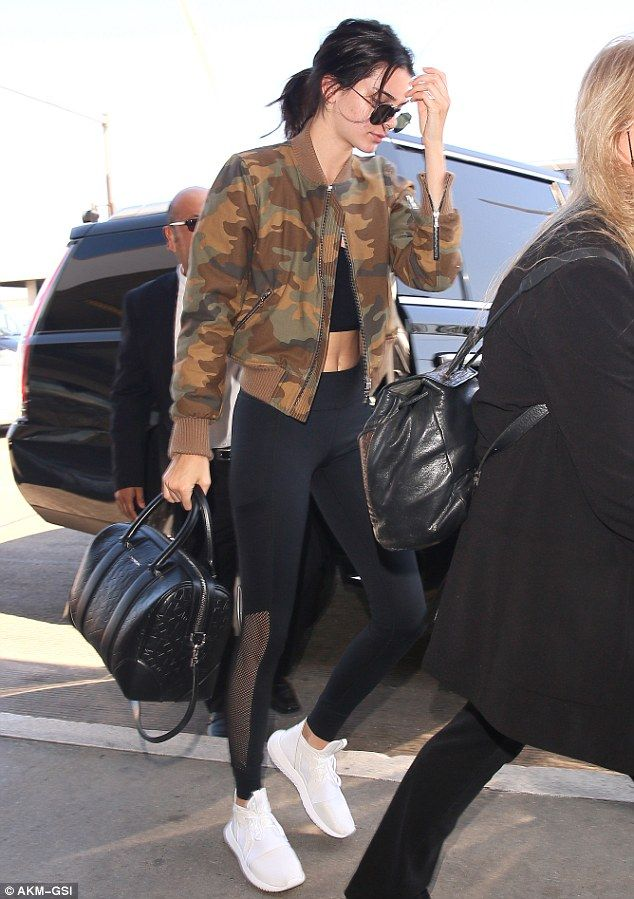 Toned torso! Kendall Jenner flashed a hint of her bare midriff as she departed LAX airport...