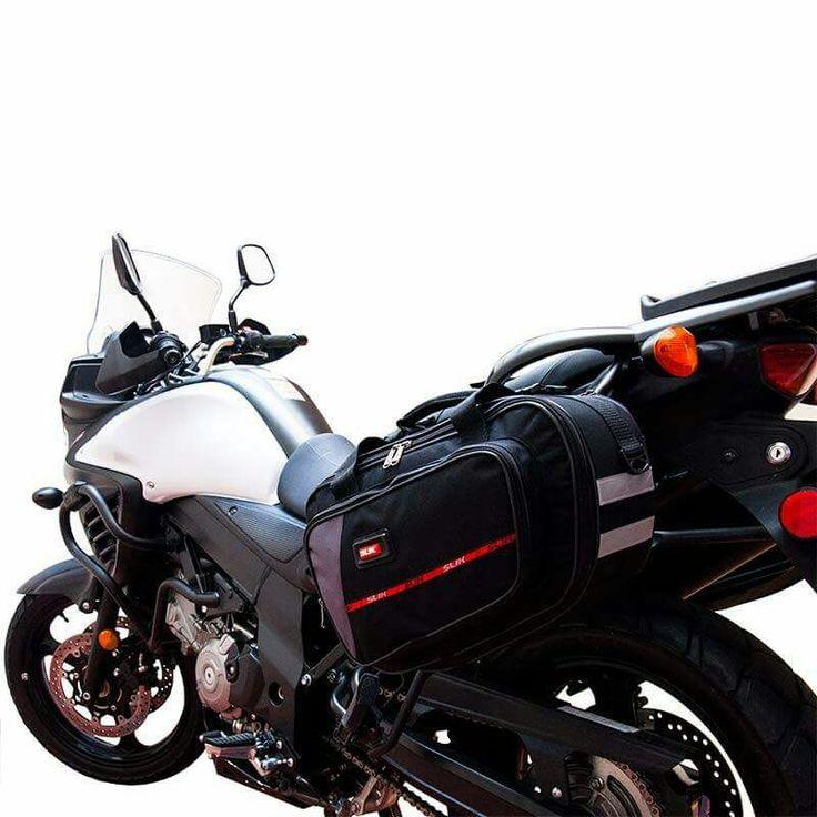Alforjas SLIK, sistema expandible, cintas reflectivas, forro protector impermeable 100%, capacidad 12 lts por und.