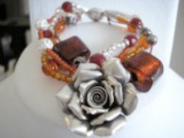 Silver flower and amber