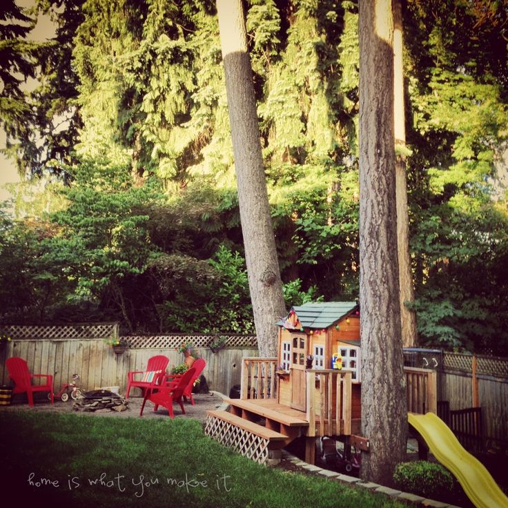our family friendly backyard with play/tree house and fire pit