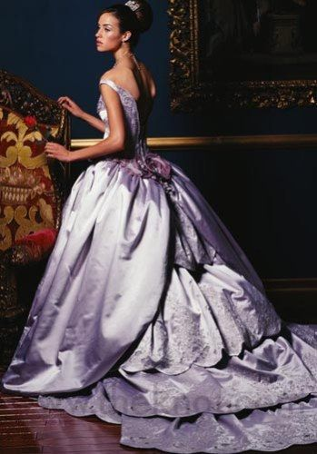 Before Queen Victoria (1840) brides wore colorful dresses rather than silver or white. They did this so the brides could wear the dresses for other social occasions. Purple wedding dress - Sophia Tolli
