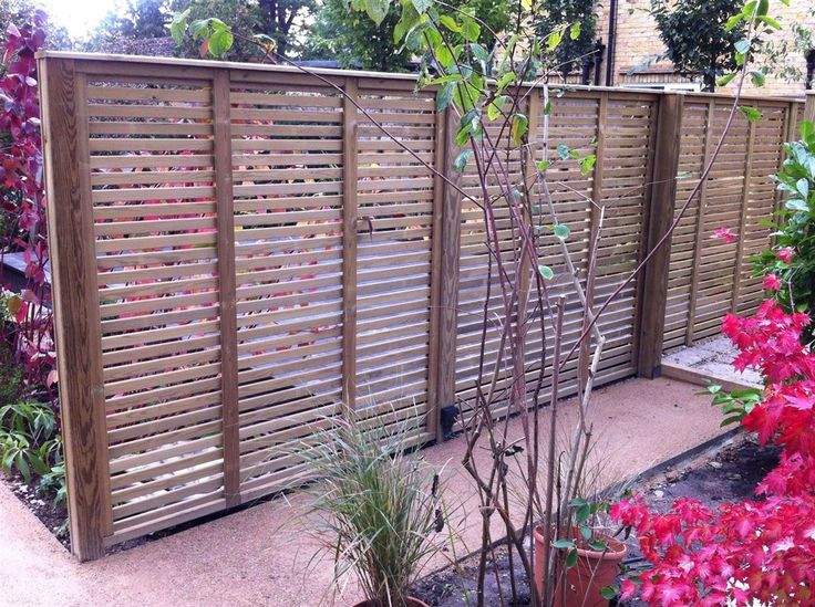 Slatted Fence Panel Used As A Garden Screen, Ideal For Sectioning Off Areas  Of The