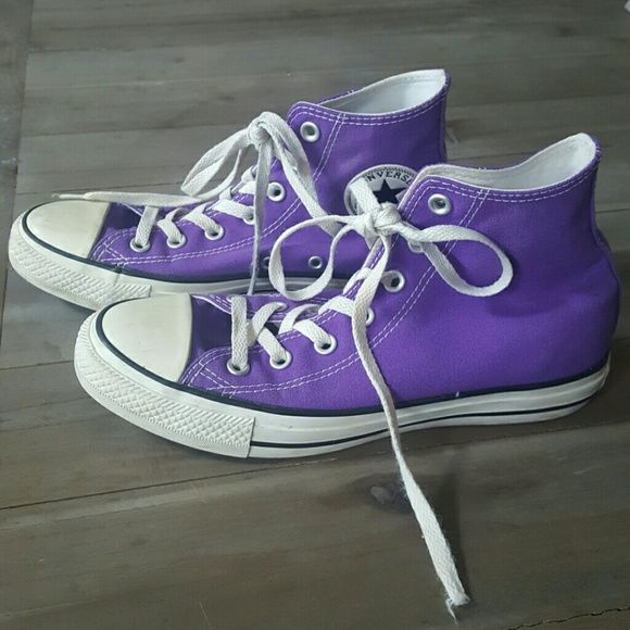 Purple High Top Converse Sneakers Purple hightop Chucks! Canvas and soles are in great condition. Could use a new pair of laces. Men's 6. Women's 8. Converse Shoes Sneakers