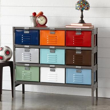 "Steel lockers salvaged from earlier lifetimes reinvigorate modern storage, refurbished with bright powder-coating and a sleek gray frame. Each vented 12""W x 12""D x 7""H drawer is a different color—ideal for children, the family mudroom or your favorite crafts projects.  42""W x 13""D x 36""H."