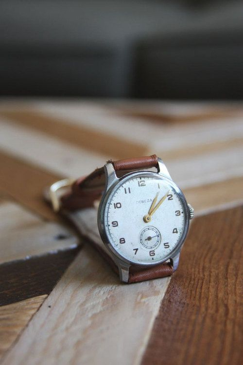 """Vintage Soviet """"Pobeda""""  You don't need an extravagant and gaudy watch, pick up something like this for under $100."""