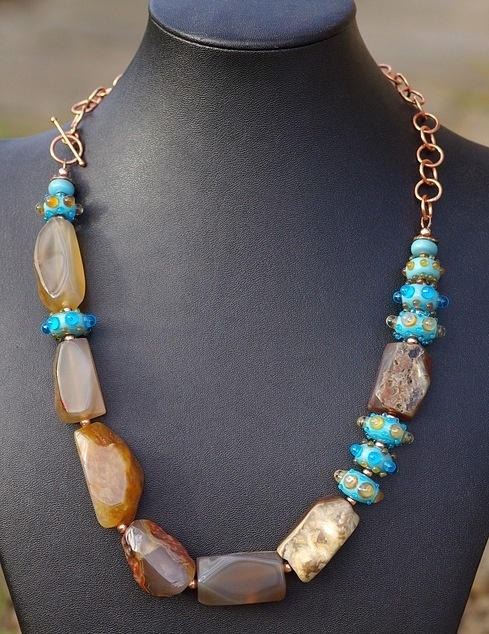 http://www.etsy.com/listing/75675179/agate-necklace-blue-lampwork-beads