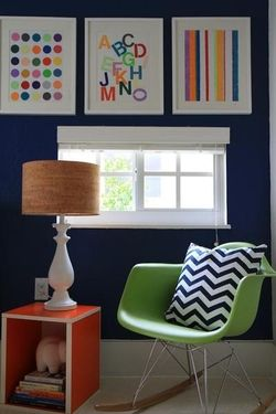 navy wall with bursts of colorful accents and artwork