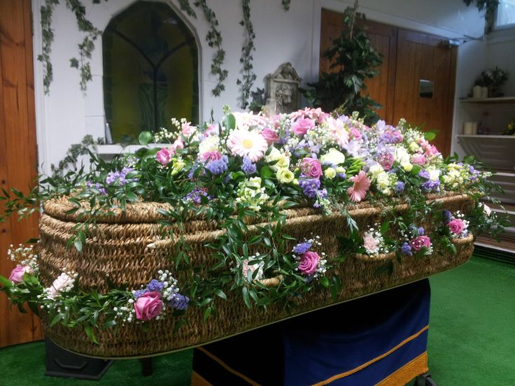 pastel garland and matching spray for whicker coffin