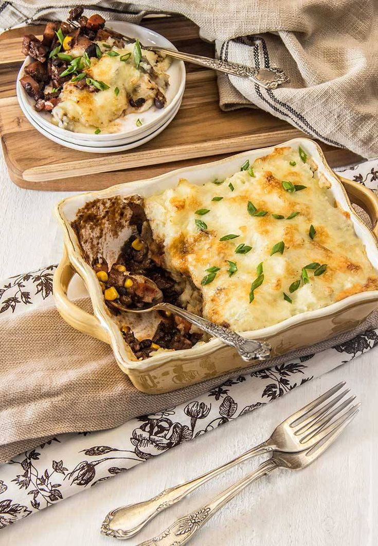 So hearty and richly flavored! Healthy vegetarian shepherd's pie recipe with a black bean & winter veggie filling. And a potato-cauliflower-cheddar crust!