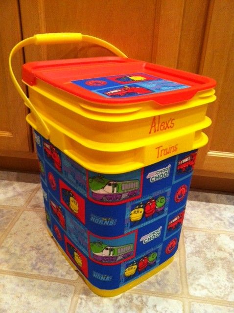 Re-purposed cat litter bucket - storage for toys. Use spray adhesive to affix fabric to the bucket. If the bucket is tapered, sew a darts in the bottom four corners so that the fabric fits snugly around the bucket.