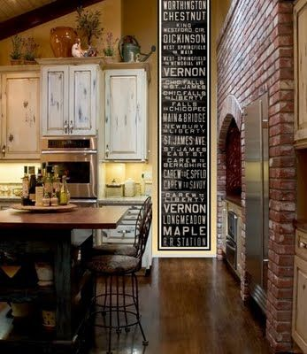 Antiqued cabinets, chalkboard and exposed brick for kitchen. love it.