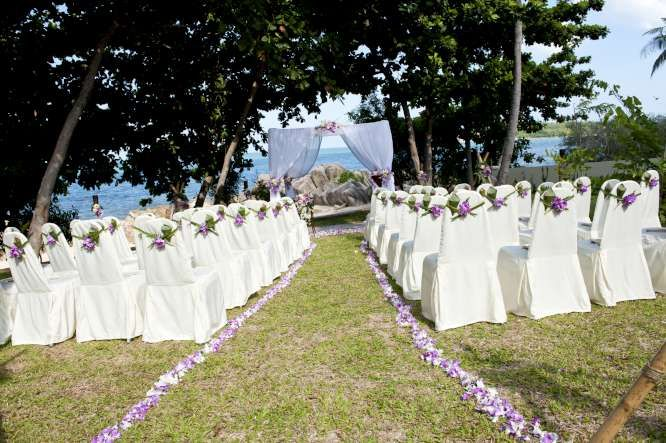 Add a splash of colour to your garden wedding ceremony with a combination of purple Sakura orchids and white lotus flowers
