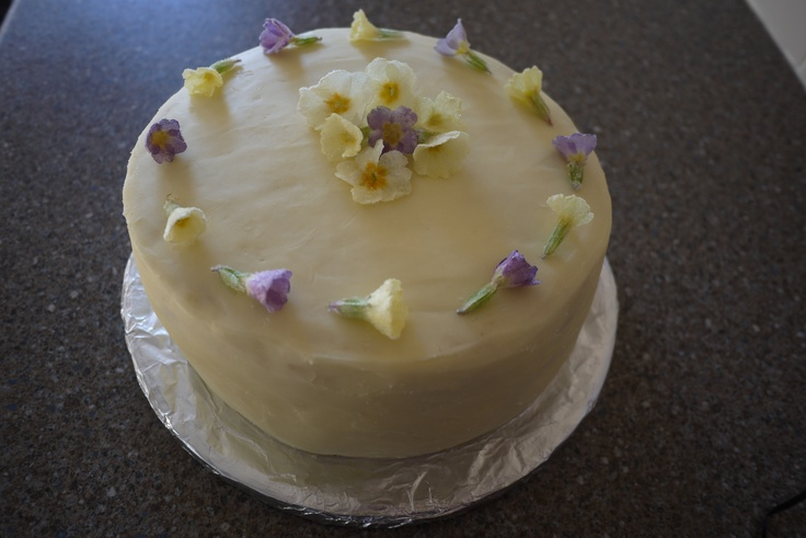 Coconut, lime and rum cake (Dan Lepard recipe) with frosted primroses.