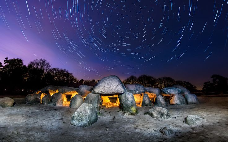Startrails over ancient burial site in de Netherlands. They r called Hunebeds.   by Michiel Buijse