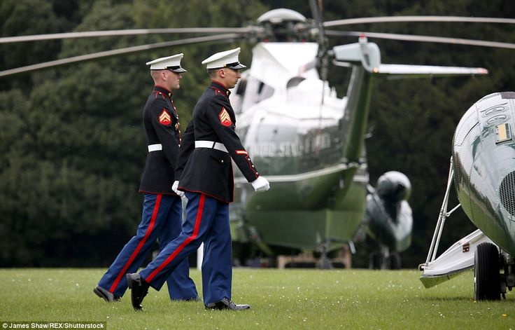 Welcome party: US Marines arrived early at Windsor Castle and greeted Mr Obama when he ste...