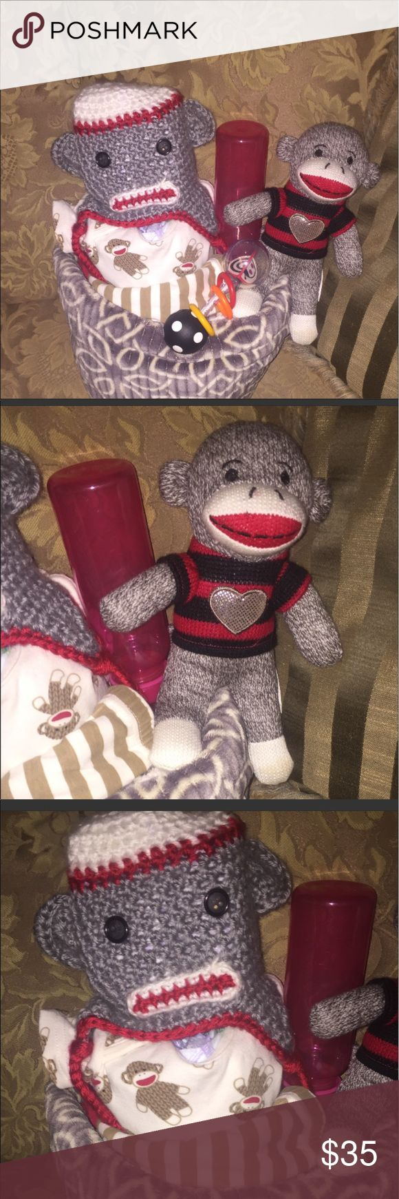 Sock monkey unisex diaper cake Comes with luvs or huggie diapers Sock monkey onesie n pants Sock monkey knitted hat  Stuff sock monkey Blanket  Bottle Rattle  Will be wrap in plastic with ribbon I can also do lamps and switchplate covers in this theme Accessories