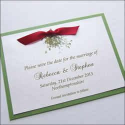 Postcard style save the date card with mistletoe and satin ribbon bow