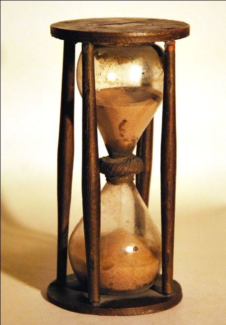 A late 18th century country made Hourglass. approx 30 minute duration. 6 inches in height.11