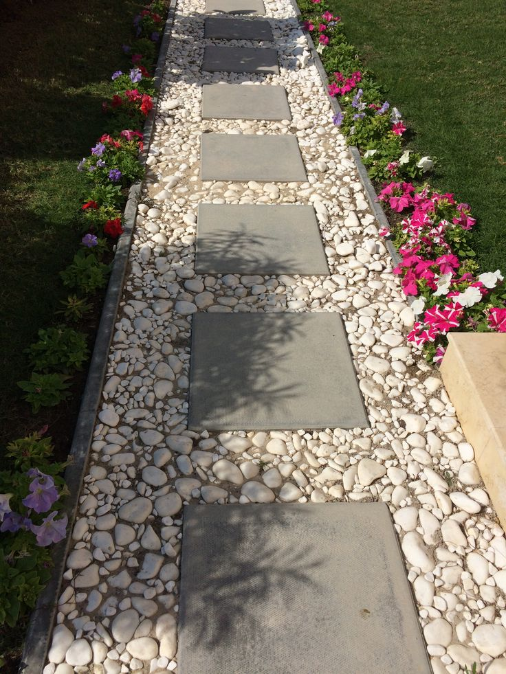 Garden Walkway Ideas you wont be able to pick just one Cement Block Tiles Bordered By White Pebbles For A Simple Pathway