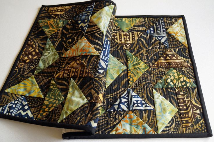 Tribal Batik Quilted Patchwork Table Runner in Black, Brown, Green, Orange, Blue and Tan, Contemporary Table Covering by MyBitOfWonder on Etsy https://www.etsy.com/listing/236251398/tribal-batik-quilted-patchwork-table
