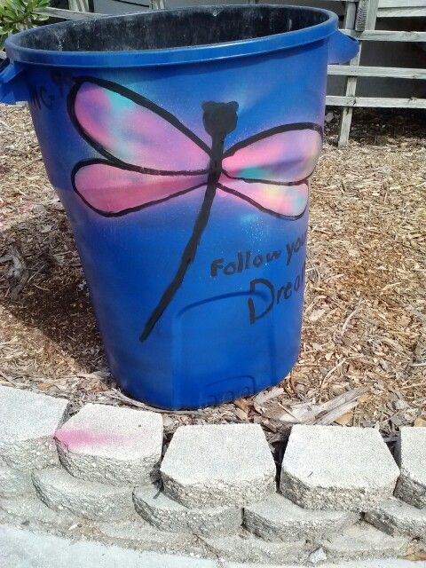 Painted trash can.