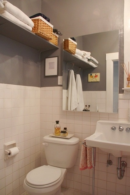 high shelving for towels and baskets for small bathroom in an older home