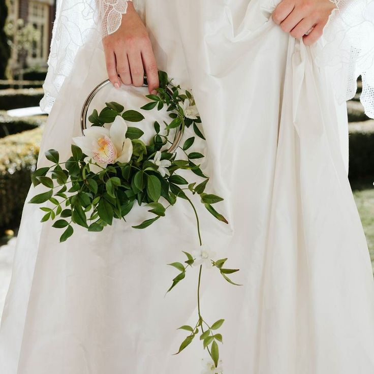 Modern ring / hoop style wedding bouquet alternative with pretty, delicate flowers
