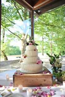 I would use a wooden case of champagne for a cake stand