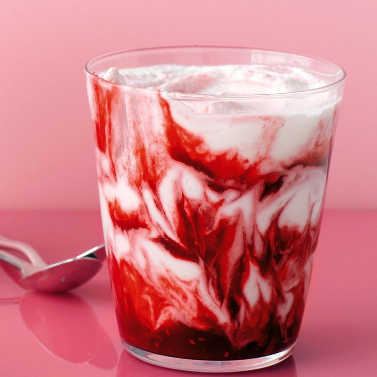 Raspberry puree is artfully swirled through whipped cream to create this fun and easy dessert.