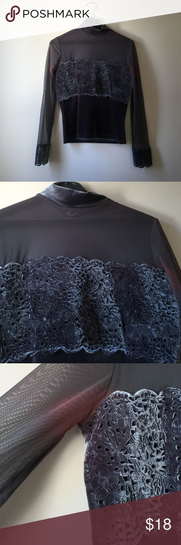 Grey velvet and sheer top from Faust Paris. Grey velvet on the bottom of the shirt and the collar. On the top of the shirt it's sheer gray. Very beautiful intricate designs. The brand is Faust Paris. Has discoloration on the underarms as photographed Faust Paris Tops Blouses