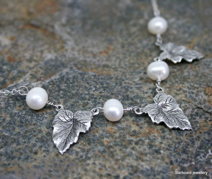 A beautiful three leaf necklace with silver plated leaves approx 15mm x 12mm. Each leaf is separated by a single 6mm freshwater pearl wired on sterling silver. Necklace is completed with a sterling silver chain. Total length 18 inches approx.  #leaf #necklace #pearl #pendant #silverplated