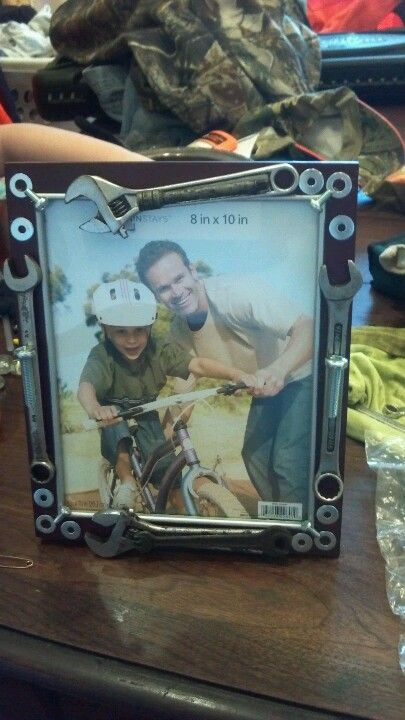 Picture frame to remember loved one - made for diesel mechanic out of his tools---- I don't think people appreciate their tools on picture frames.  Even if this is cute.