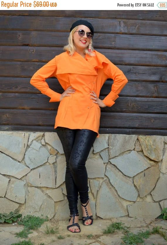 Orange asymmetrical blouse made of pure cotton. Very stylish blouse with French cuffs. Easy to wear, comfortable, playful and perfect for Fall. Material: 95% cotton, 5% elastane Care instructions: Wash at 30 degrees. The model in the picture is size S.  Can be made in ALL SIZES.  If you have any other specific requirements, do not hesitate to contact me!  I DO NOT CHARGE EXTRA MONEY for custom made items.   All you need to do is send me your measurements. Below, you will find a table with…
