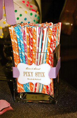 The Pixy Stix at this candy buffet table look perfect standing upright in the square glass jar. It is important to consider not only what you will include with your wedding candy buffet, but how you will display your selections.