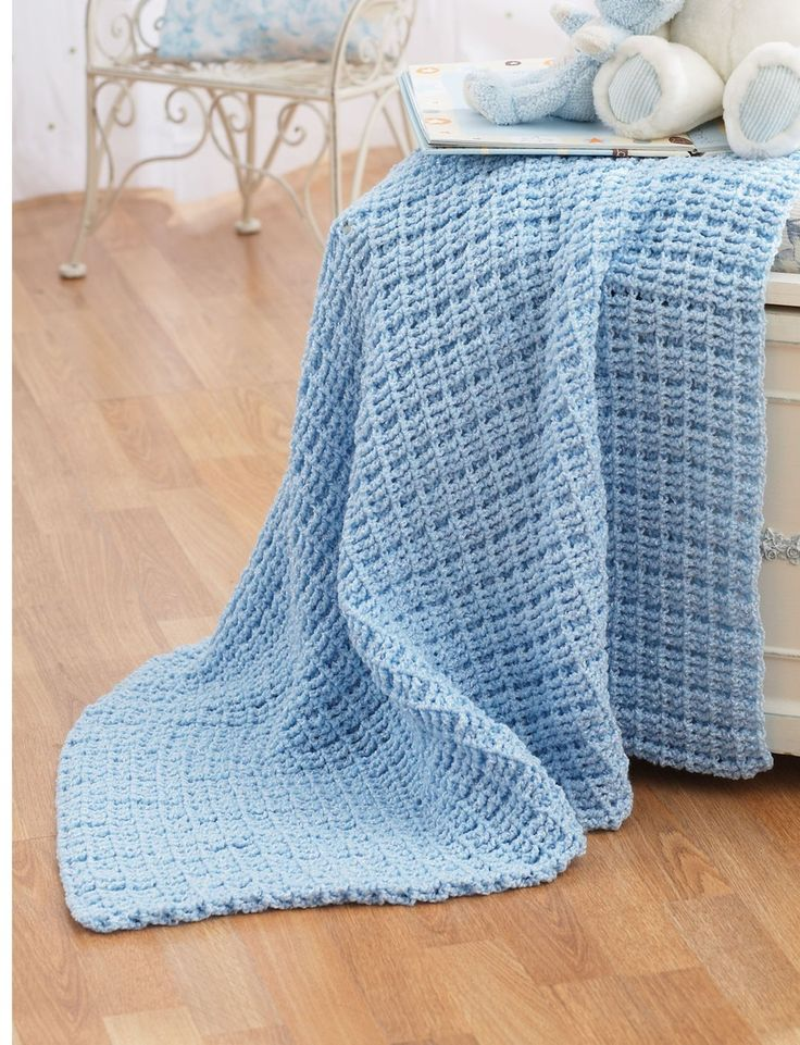 Baby Blue WWhen it comes to crochet baby blanket pattern, you don't need to go over the top to create a classic blanket. Just let this Baby Blue Waffle-ghan show you. With one simple color, you'll crochet an easy crochet baby blanket full of texture.