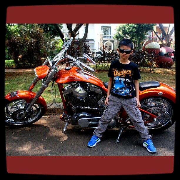 "Malik's wearing ""born to be free"" t-shirt and corduroy pants from oshborn kidz clothing"