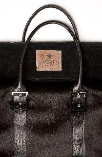 5784 Travel Bag by Jacaru. Natural Cow Hide Fur. Crocodile Print handles.