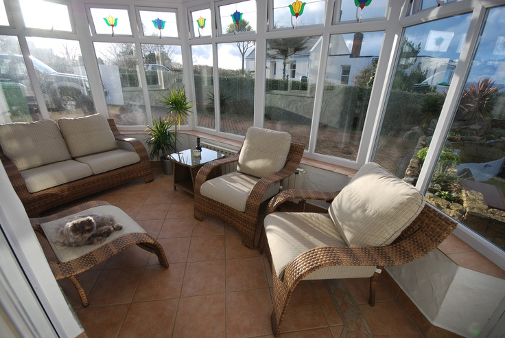I choose chunky rattan furniture for the conservatory which could also be used on the outside patio area in the summer months for special occasions.