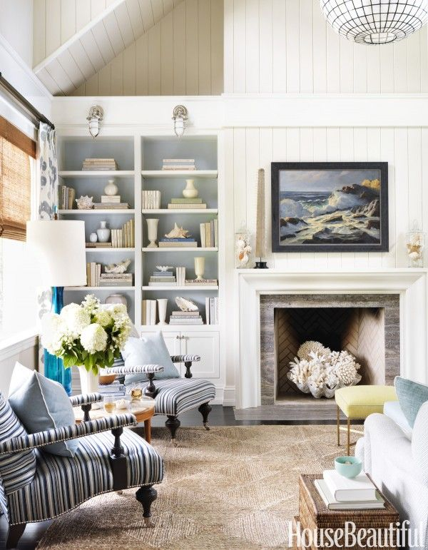 Coastal Style Living Room...love the blue in the book cases