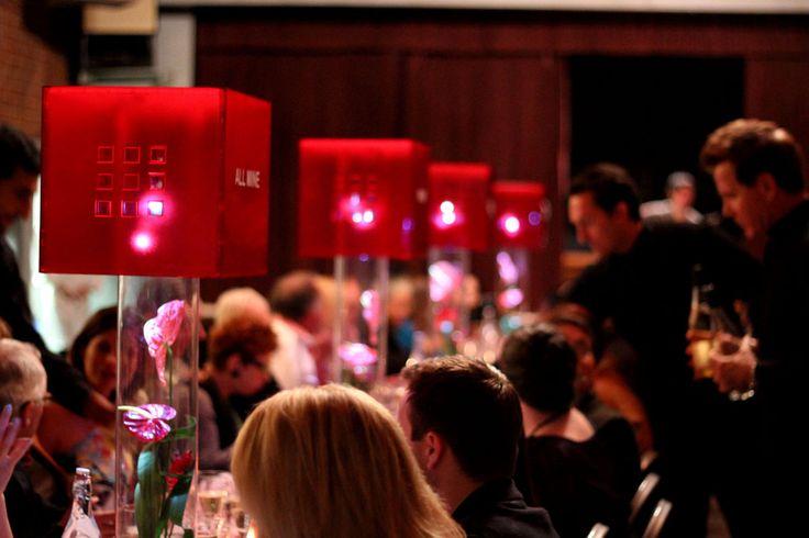 upside down ikea storage bins on tall glass vase