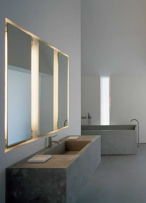 Minimalist bathroom with concrete sink and bath tub, by John Pawson. Baron House.