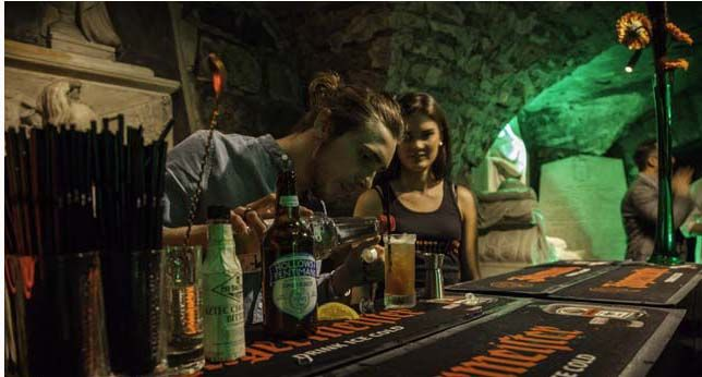 Promotional Events Ideas - An specialize Bartender surprising the attendees with a great variety of  cocktails made with Jägermeister.