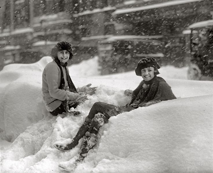 """Blizzard, January 28, 1922."" In Washington, D.C., freezing weather is no match for a sunny disposition. National Photo Company glass negative."