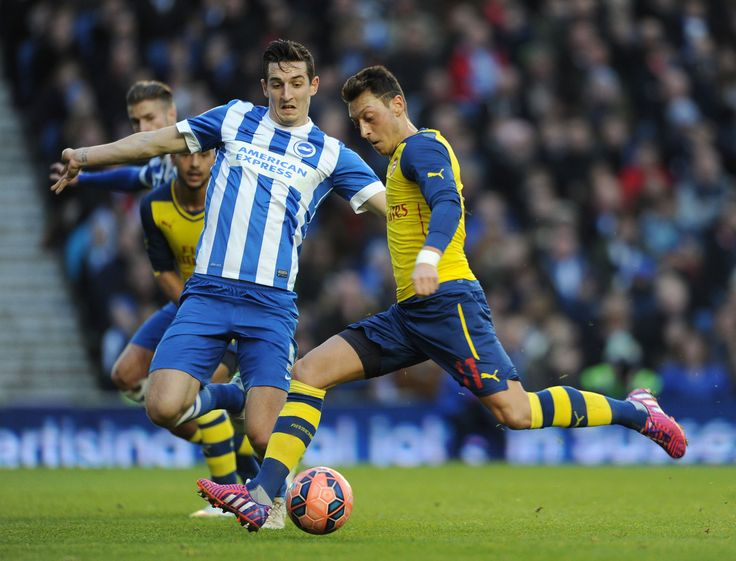 Mesut Ozil coolly slotted home the second goal for Arsenal in the 3-2 win over Brighton & Hove Albion.