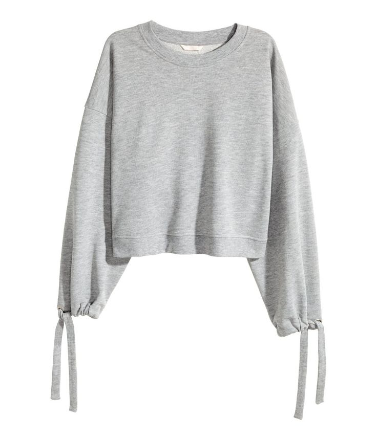 Short, wide-cut sweatshirt. Dropped shoulders, drawstrings along sleeves, and ribbing at neckline and hem.