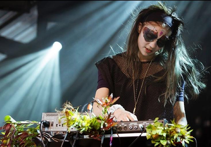 Grimes wearing a Mars da Favela 'Crystals not Pistols' necklace. Meredith Music Festival , Australia.