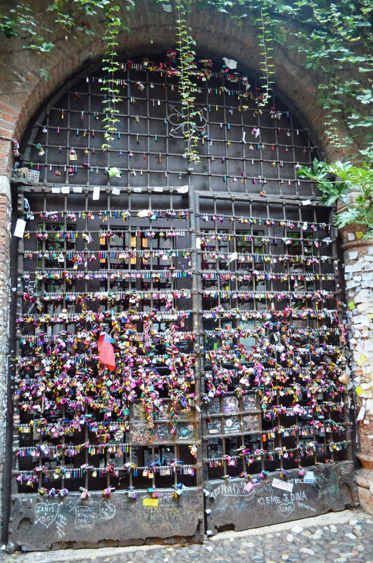 In Verona, the town of Romeo and Juliet and below their house, lovers chain their love on the gate forever.